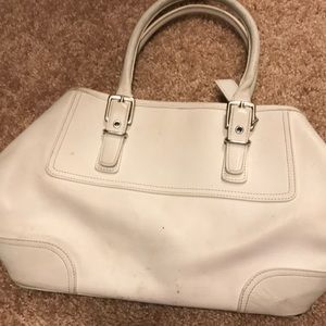 A white used purse that Dosent look that used